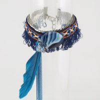 Bracelet hippie chic agrémenté de plume et perle